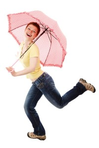 energetic woman with umbrella