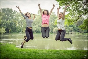 Ladies jumping outside